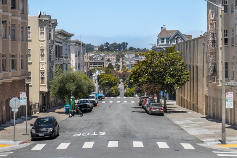 "#4: Square to square: looking down Pierce from Alamo Square to Alta Plaza and its locally notable steps. I just love how this images visualizes a transect of the Western Addition—a regular, everyday part of the city—in a way that only hills can. <small>(<a href=https://thefoxandthecity.com/files/P1010773.jpg"" target=""_blank"">Full size</a>)</small>"
