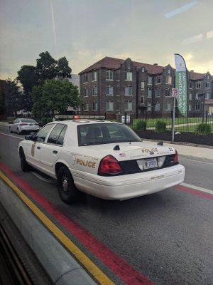 A police car blocks the Red Line's bus lane